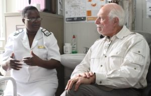 Dr. Lowell Schnipper talking with Mrs. Angeline Bowman, a Registered General Nurse and Midwife, and manager of St. Albert's Cervical Cancer Prevention Program.