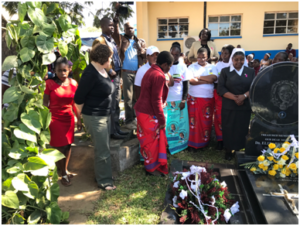 People gather at Dr. Tarira's grave site.