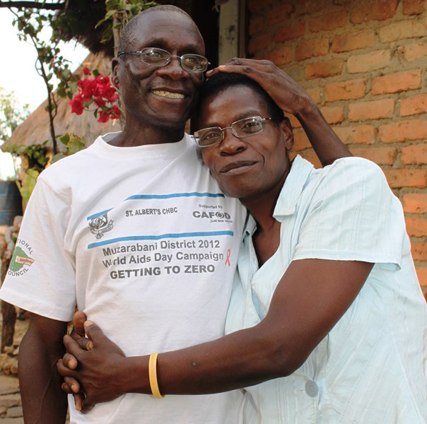 "Photo of Zimbabwean woman Rosa Sande and her husband Samuel Mateo. Rosa visited the  St. Albert's cervical cancer prevention clinic for screening. Serious precancerous changes were found. A St. Albert's surgeon performed a  hysterectomy that prevented the cancer. Rosa encourages other women to  be screened, especially those in remote areas. ""It can save a woman's  life,"" she says."