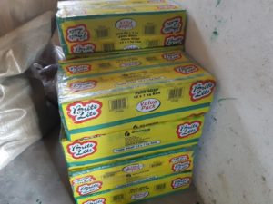 Photo of pallet with laundry soap that is to be included in food hampers.