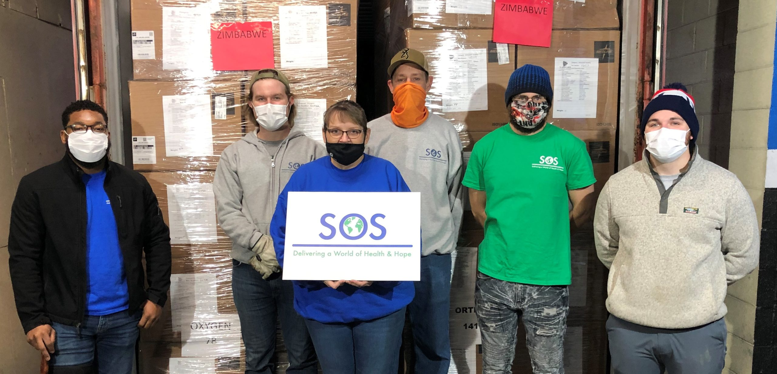 SOS team after loading the container of medical supplies for St. Albert's Mission Hospital