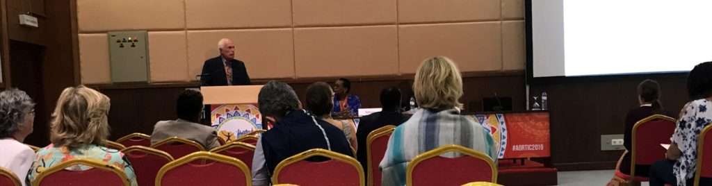 Photo of Dr. Lowell Schnipper at the 2019 AORTIC cancer conference presenting the findings of the HPV study conducted at Karanda Mission Hospital.