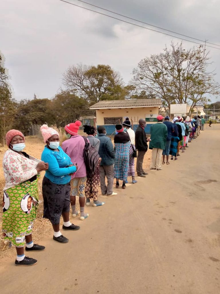 Photo showing line of local people waiting to be vaccinated for COVID-19 at St. Albert's Mission Hospital, 23 August 2021